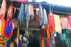 Dyed textiles. Dyed bunches of wool hanging to dry in marrakesh`s dyers souk, morocco stock photo