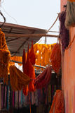 Dyed textiles. Dyed bunches of wool hanging to dry in marrakesh`s dyers souk, morocco stock photography