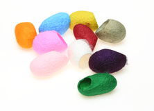 Dyed cocoons Stock Photos