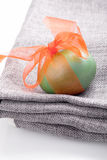 Egg with ribbon on a blanket Stock Image
