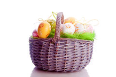 Dyed easter eggs in a basket Stock Photos