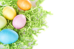 Dyed Easter eggs on green confetti Royalty Free Stock Photo