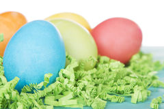 Dyed Easter eggs on green confetti Stock Image