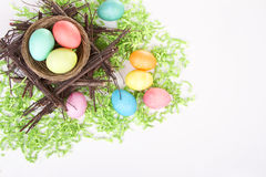 Dyed Easter eggs in a nest Stock Photography