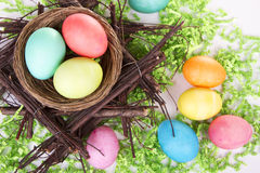 Dyed Easter eggs in a nest Stock Photos