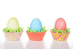 Dyed Easter eggs in a nest of green grass Stock Image