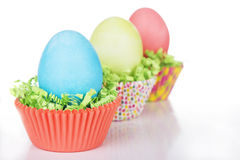 Dyed Easter eggs in a nest of green grass Stock Photography