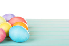 Dyed Easter eggs on a turquoise blue wooden panel Stock Image
