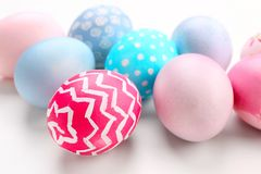 Dyed Easter eggs on white background, closeup royalty free stock photography