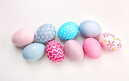 Dyed Easter eggs on white background stock image