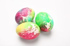 Dyed Easter eggs on white background stock photos
