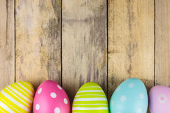 Dyed easter eggs on a wooden background Stock Photo