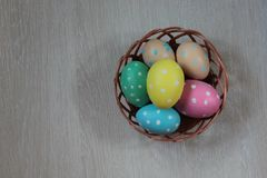 Dyed Easter eggs on wooden background. Dyed Easter eggs lie on wooden beige background royalty free stock photography