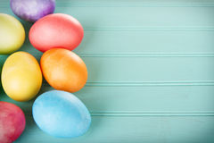 Dyed Easter eggs on a wooden panel. Dyed Easter eggs on a turquoise blue wooden panel stock photo