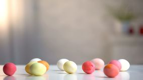 Dyed eggs lying on table, preparation for religious holiday, Easter celebration. Stock photo royalty free stock photography