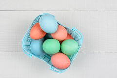Dyed Eggs in Plastic Basket Royalty Free Stock Photos