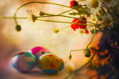 Dyed eggs and wildflowers. The egg, an ancient symbol of new life, has been associated with pagan festivals celebrating spring Royalty Free Stock Image