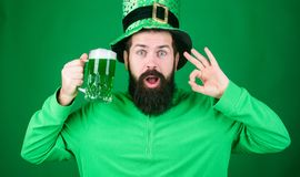 Dyed green traditional beer. Patricks day party. Alcohol beverage. Symbol of Ireland. Man bearded hipster drink beer. Irish pub. Highly recommend. Drinking stock photo