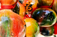 Dyed and painted gourd crafts with a handwritten Chinese character meaning `good fortune`. Dyed and painted gourd crafts in Japan with a handwritten Chinese royalty free stock photos