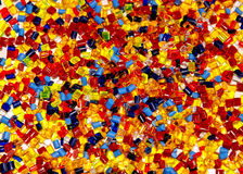 Dyed plastic granulate. Dyed mixed thermoplastic granulated, coloured background Royalty Free Stock Photo