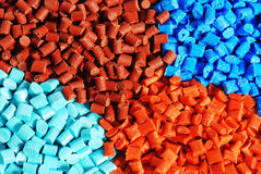 Dyed plastic granulate. Colored granulat pellets of thermoplastic material Royalty Free Stock Photo