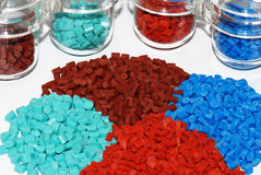 Dyed plastic granulate in test glasses. Colored granulat in test glasses for analyse Royalty Free Stock Photo
