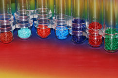 Dyed plastic granulate in test glasses. Colored granulat in test glasses for analyse Stock Image