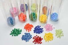 Dyed polymer resin in test glasses Stock Photo
