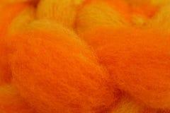 Dyed sheep wool. Macro of braided orange yellow dyed sheep wool Stock Photography