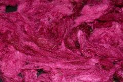 Dyed sheep wool. Red dyed sheep wool laying out to dry royalty free stock photos