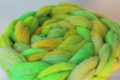 Dyed sheep wool roving. Dyed American Tunis sheep wool roving stock image