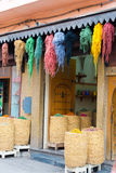 Dyed textiles. Dyed bunches of wool hanging to dry in marrakesh`s dyers souk, morocco royalty free stock photo