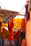Dyed textiles. Dyed bunches of wool hanging to dry in marrakesh`s dyers souk, morocco stock images