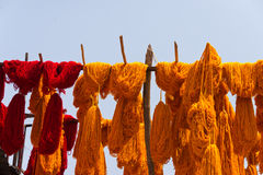 Dyed textiles. Dyed bunches of wool hanging to dry in marrakesh`s dyers souk, morocco stock image