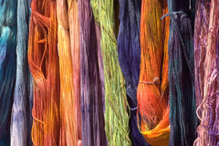 Dyed wool at a farm fair. Hanks of various colors of hand dyed wool at a local farm fair royalty free stock photo