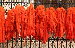 Dyed Yarn. Red dyed yarn hanging to dry on a fence in the city of Marrakesh, Morocco royalty free stock photo