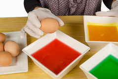 Dyeing Easter eggs stock images