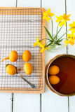 Dyeing Easter eggs natural way with turmeric for mustard - yello Royalty Free Stock Images