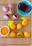 Dyeing Easter eggs natural way. Dyeing Easter eggs natural way with turmeric for mustard - yellow color and with beet for pink color Stock Photo