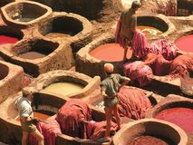 Dyeing Work. Men working in Dyers' Souk in Marakech, Morocco stock photo