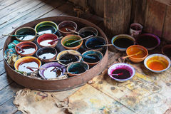 Dyes for coloring textile. Bowls with dyes for coloring fabrics, in Myanmar Royalty Free Stock Photography