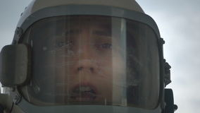 Dying Astronaut. Close up shot of female astronaut dying because the lack of oxygen and helemt depressurization stock footage