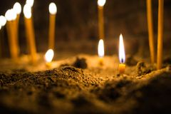 Dying Candle In The Sand Royalty Free Stock Photo