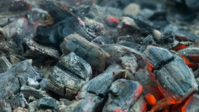 The dying coals in the brazier smoke and burn stock footage