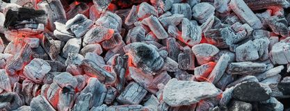 Dying fire on black, ashy coal prepared for barbecue grill royalty free stock image