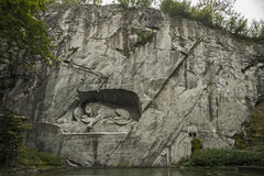 The dying lion. The monument `The Dying Lion` is in Switzerland, in the city of Lucerne. Created in memory of the dead soldiers in 1792 at the Tuileries. The Stock Photography