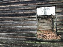 A dying village. Old abandoned dilapidated house. Log building. Stock Photos
