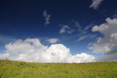 Dyke with cloudscape Royalty Free Stock Images