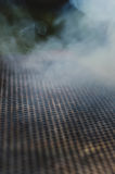 Dym przecieka dziurkowatą kratownicę Obraz Royalty Free