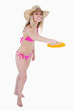 Dynamic and attractive teenager playing frisbee Royalty Free Stock Image